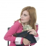 Young woman engaging in employee embezzlement