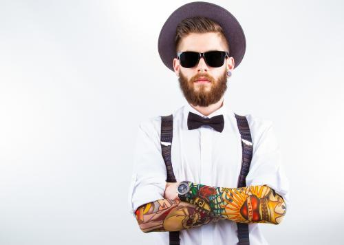 this tattooed, bearded hipster is a walking dress code violation