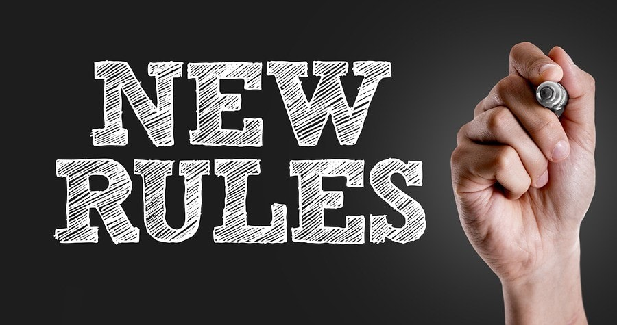 Hand writing the text: New Rules