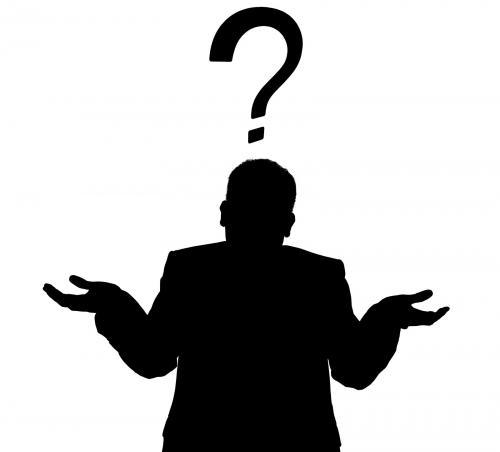 silhouette of a man in a business suit giving a shrug with a question mark, representing uncertainty about Trump FLSA overtime rules
