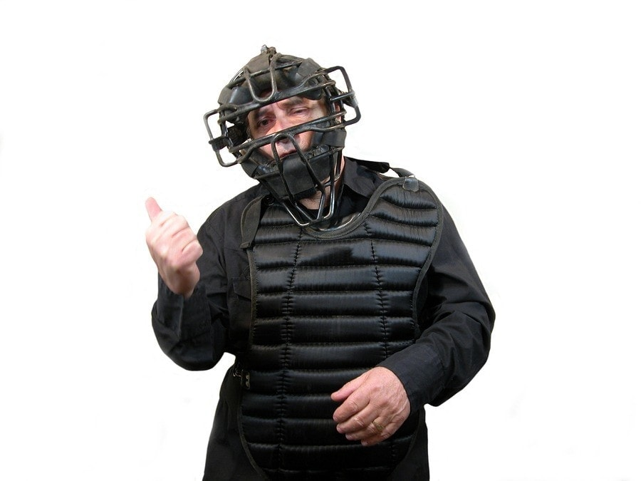 umpire signaling you're out, symbolizing a three strikes employee discipline policy