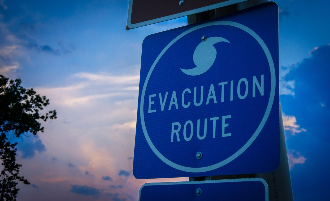 Evacuation route sign -- who gets paid when your office closes due to bad weather?