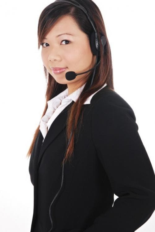image of young asian female employee wearing headset and looking ambiguous to illustrate joint employment - whose employee is she?