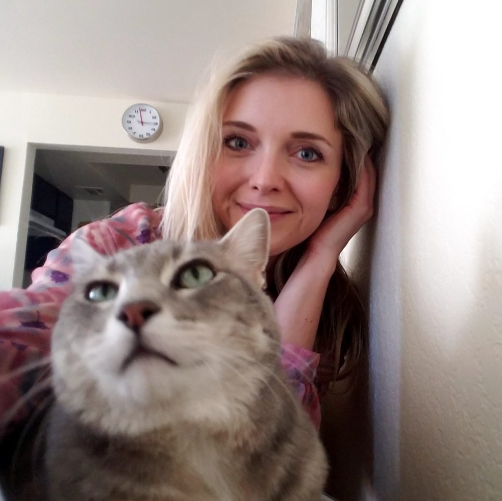 Close up of Solution Center Advisor Tiana Starke and her gray cat Lebowski
