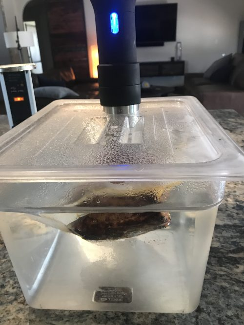 At home sous vide setup in clear plastic tub