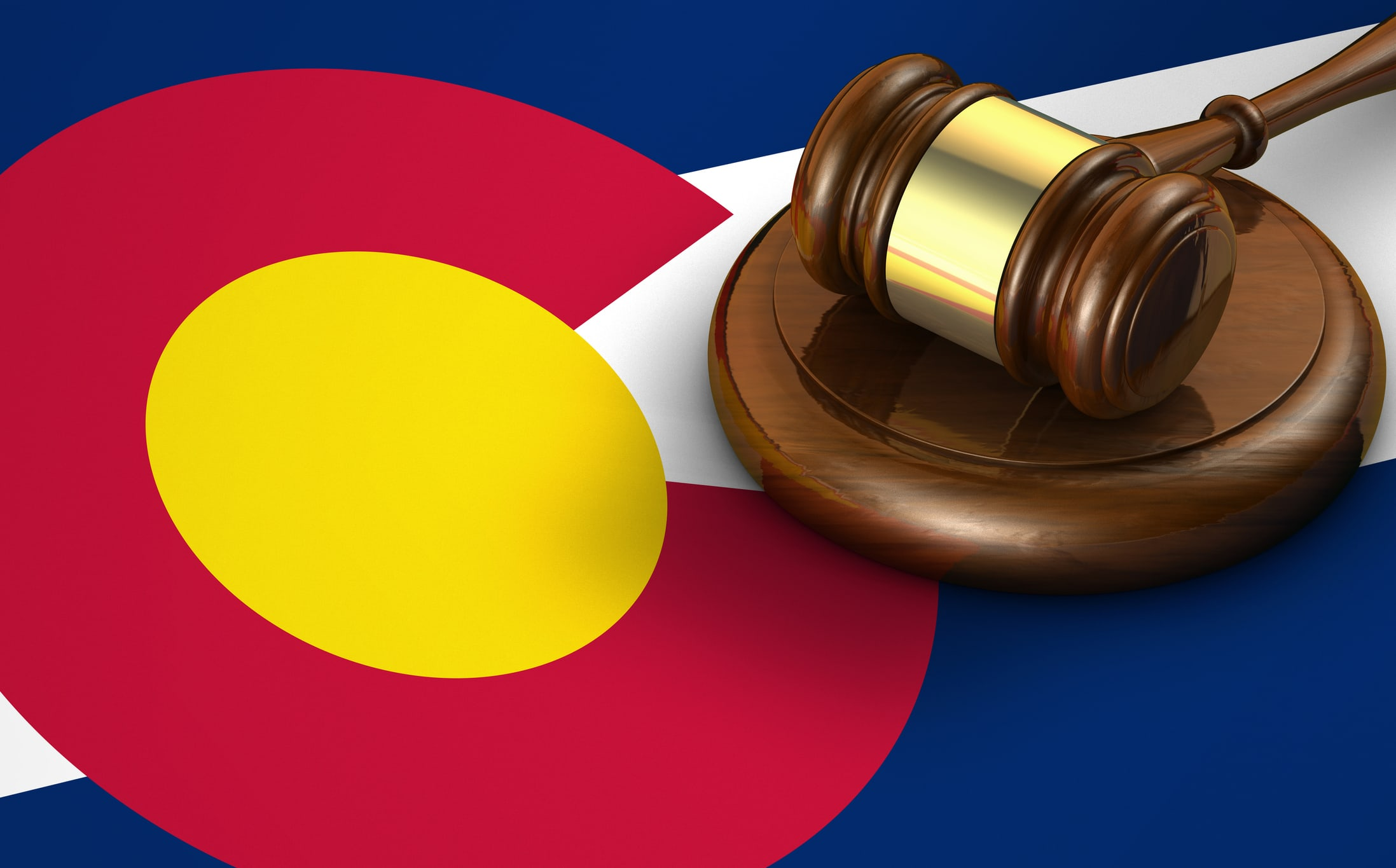 Colorado US state law, code, legal system and justice concept with a 3d render of a gavel on the Coloradoan flag on background.