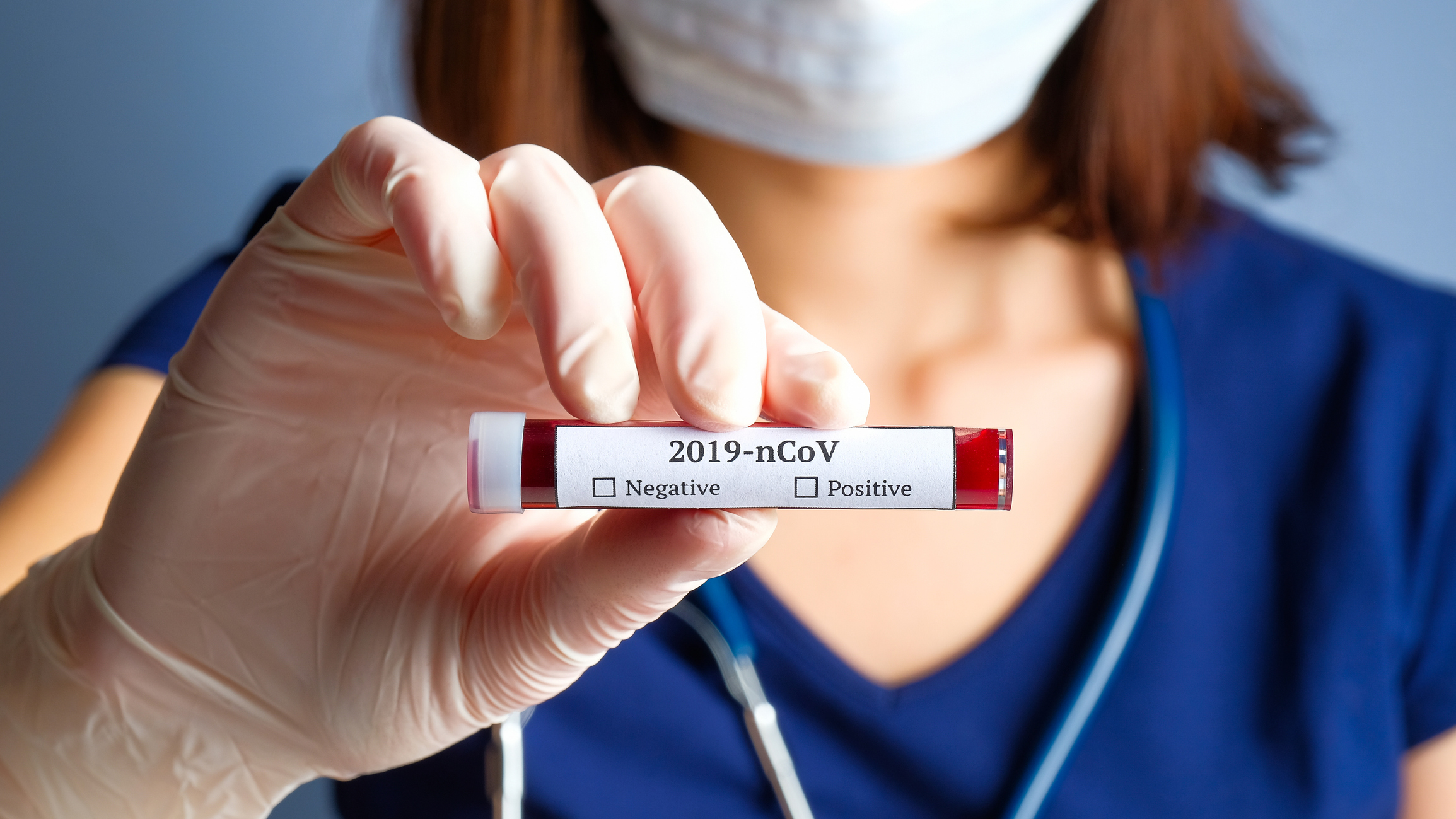 Nurse holding test tube with blood for 2019-nCoV analyzing. Novel Chinese Coronavirus blood test concept