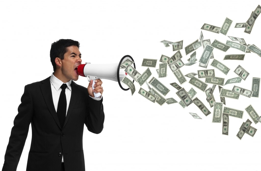 Businessman yelling into a megaphone with money coming out of it, speaking money to the side